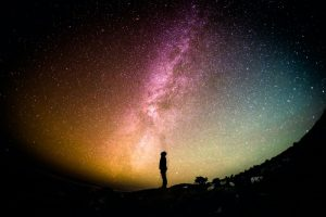 Person standing at the edge of the universe